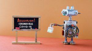 робот показва табела за коронавирус